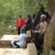 The group led by Rev Webster Donald Kaisi gathers for a photograph at the Nchenjere Missionary Graves site in Chitipa, CCAP Livingstonia